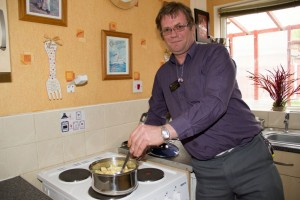Stove Guard system helps gentleman with Narcolepsy manage safe cooking . Picture courtesy of North Lincolnshire Homes and Humberside Fire and Rescue Service